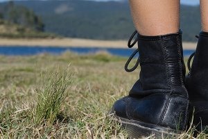 Close up of female hiker on field