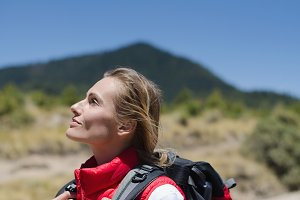 Female hiker looking up