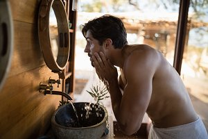 Man washing face from water in cottage 4k