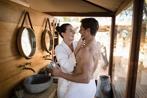 Couple having fun together in cottage