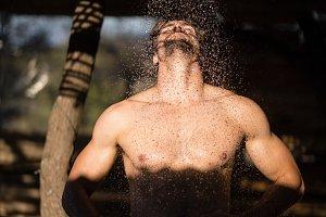 Man taking bath in shower