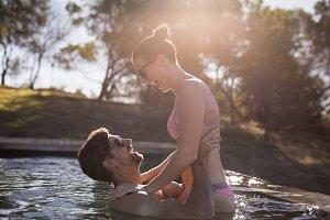 Couple having fun together in pool