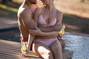 Couple relaxing in pool during safari vacation