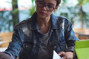 Female university student studying at desk