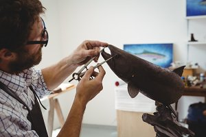 Craftsman working on fish sculpture