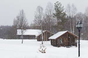 Three wooden house in winter in the