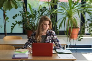 Young female student using laptop