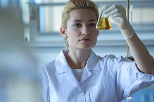 University student doing a chemical experiment in laboratory