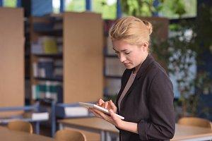 University student using digital tablet in classroom