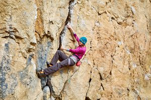 female rock climber on the cliff
