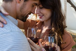 Couple with wineglasses romancing