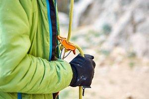 man climber belayer