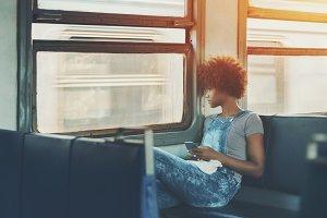 Black girl in suburban train