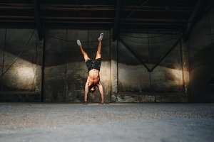 Fit man doing handstand
