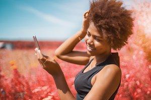 Black girl fixing hair, vivid colors