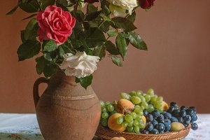 Still life with a roses and fruits