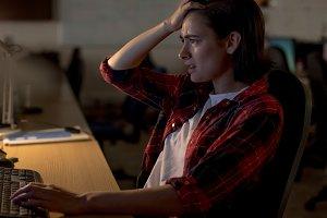 Frustrated executive using desktop pc at desk
