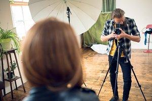 Photographer photographing female fashion model