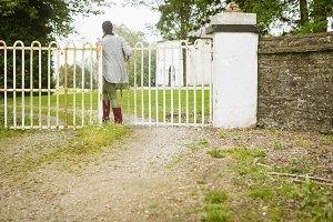 Woman walking towards gate