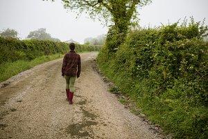Rear view of woman walking on path