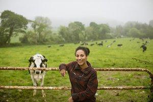 Portrait of happy woman standing in field