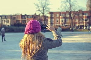 Girl making a photo with smartphone