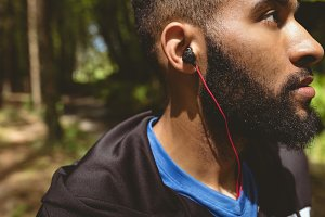 Close up of young male listening music