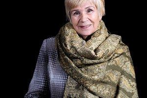 An elderly woman in a coat
