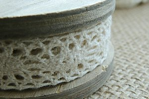 Cotton lace on vintage bobbin.