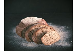 Sliced homemade sourdough rye bread, copy space