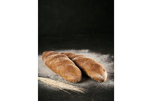 Two whole homemade rye loaf bread, copy space