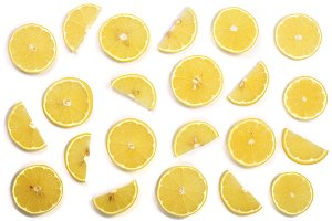 Slices lemon isolated on white background. Flat lay, top view