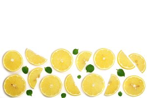 Slices lemon with mint leaves isolated on white background with copy space for your text. Flat lay, top view