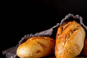 Homemade Italian bread. Fresh bakery. Dark background.