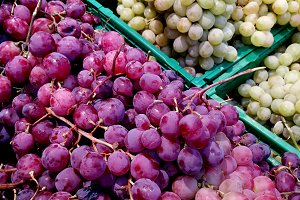 Red and white grapes at market