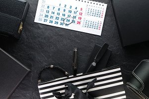 Package with a black bow and with gifts, different boxes, calendar