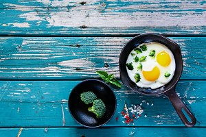 Fried eggs with broccoli