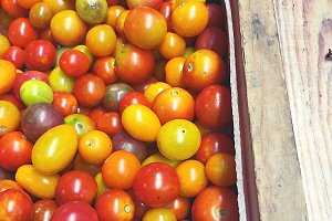 Farm stand tomatos in wooden box