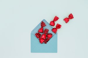 Holiday greeting, sweets in envelope
