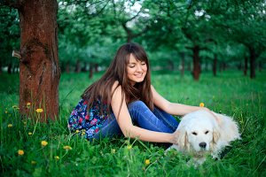 Girl and retriever in park