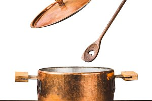 copper cooking pot with lid , spoon