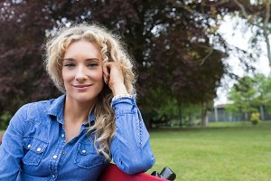Portrait of smiling woman sitting on bench