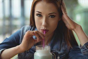 Portrait of woman having drink in cafe