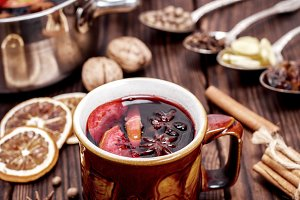 mulled wine in brown ceramic mug