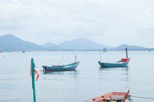 Fishing boats moored at the shore.
