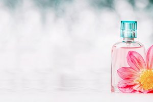 Perfume bottle with flowers, banner