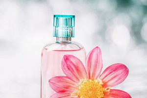 Perfume bottles , flowers, close up