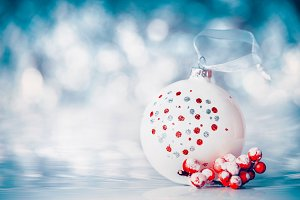 Christmas bauble at blue bokeh