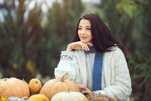 Autumn woman with pumpkins outdoor