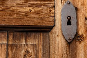 Close-up old wooden door keyhole